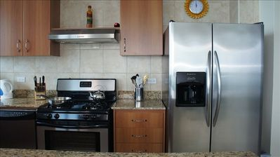 Full size side-by-side refrigerator, stove and cook top … everything you need!