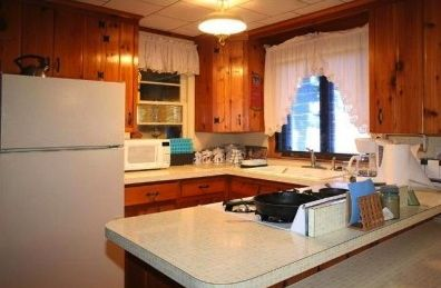 Kitchen in cabin. Gas Range, full size refrigerator, microwave and a lake view!