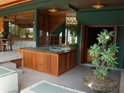 Jacuzzi and dining area of terrace