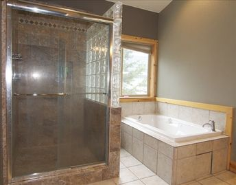 Master bath with rainfall shower and Jacuzzi tub