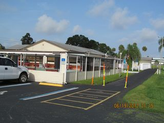 New Port Richey mobile home photo - Shuffle Board Court and Club House on way to Pool