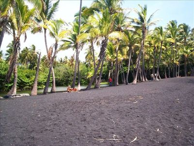 Our own serene black sand beach; we provide chairs