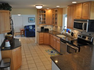 Bethany Beach house photo - The fully-stocked kitchen has counter seating for four.