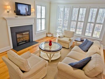 Martha's Vineyard Rental Edgartown Home: Sunny Living Room Has Wall Of Windows, Fireplace & Flat Screen TV
