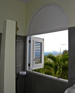 A private, open air shower offers views of down islands.