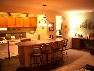 Bend condo photo - Six stools for up to six sleepers and a handy kitchen. Desk in the background.