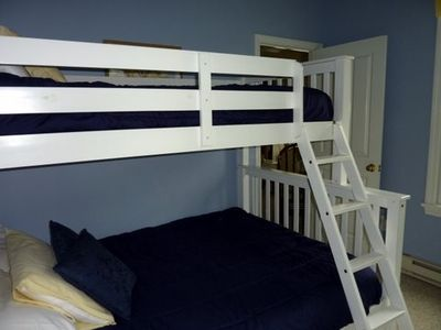 Double bed with twin bunk above AND twin trundle below - room sleeps 4!