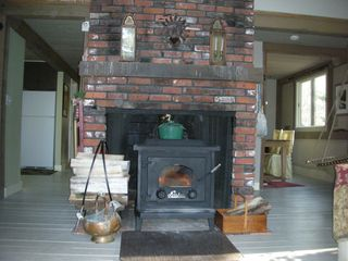 Waterville Valley house photo - A blazing fire in the wood stove feels great after playing in the snow.