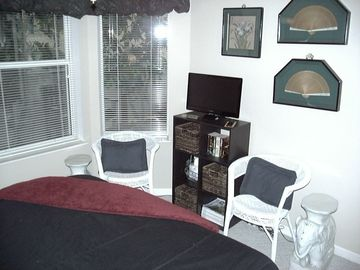 The television and sitting area of guest bedroom.