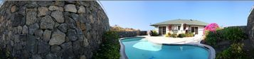 Panoramic Shot of Private Pool and Privacy Rock Wall