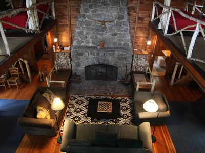 Konewago Main Lodge: two story fireplace in living room