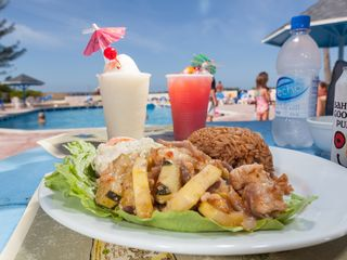 Nassau & Paradise Island villa photo - Poolside Tiki Bar & Grill serves Local Food & Tropical Drinks