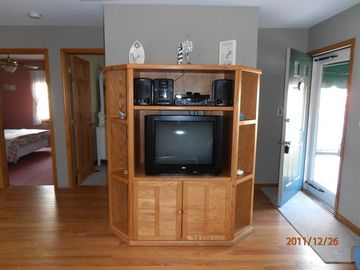 Entertainment center has TV/DVD and music shelf system