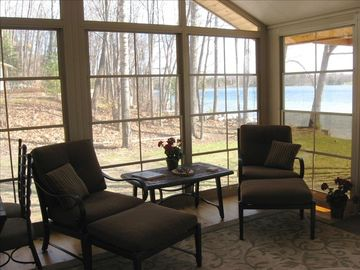 Spacious sunroom with lake view.