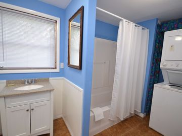 Washer & dryer are located in the new second bath accessible from the screened porch