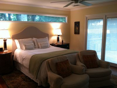 Sea Pines house rental - Queen Bedroom w Tidal Creek Views Through Large Windows and Door to Patio