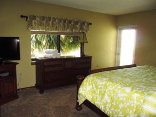 Master Suite with king poster bed - Cocoa Beach condo vacation rental photo