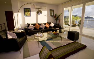 Villa C5's living space and a panoramic seaview