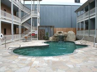 New Braunfels condo photo - Limestone Waterfall and Swimming Pool