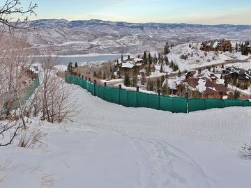 Ski run that goes directly adjacent to the home offering true ski-in/out access