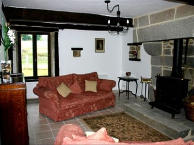 Vire cottage rental - Lounge/sitting room with log burner