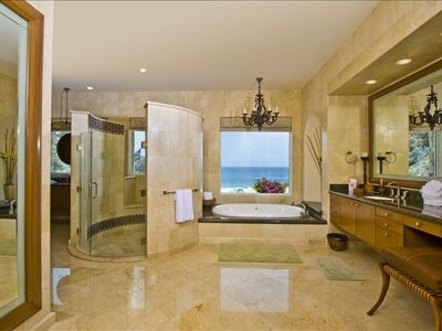 Master Bathroom with sunken Jacuzzi tub, shower, his & hers vanities and more