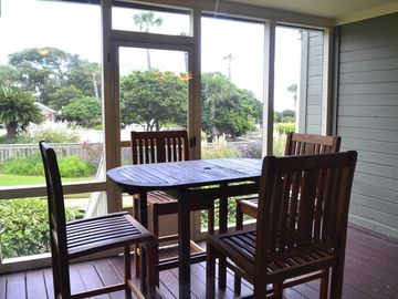 Teak Outdoor Dining Set on Screened Porch