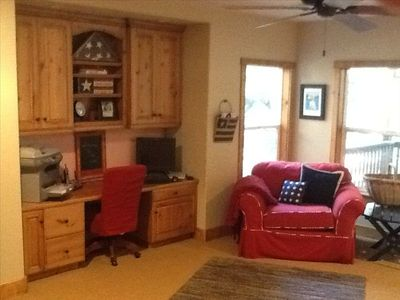 Bottom level office -- TV, broadband, WIFI, deck by the stream... email calling?