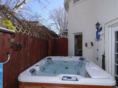 7' square multi station therapeutic spa and patio area off kitchen/family rm.