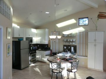 Kitchen Area with modern appliances and marble countertops