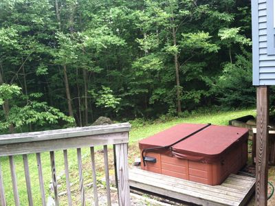 private hot tub in back yard