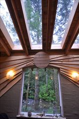 Coos Bay house photo - Sunburst below skylights from the myrtle wood cat walk