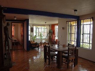Bacalar house photo - Dining room with 6 comfy chairs looking into living area, door to big bedroom.