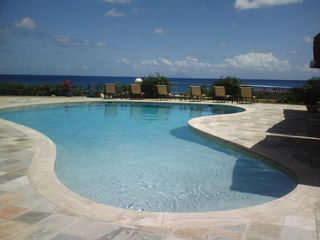Cupecoy condo photo - One of the Three Swimming pool!! with view to Ocean!!