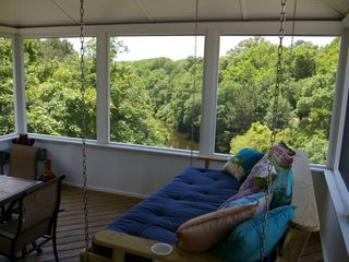Duck house photo - Custom hanging bed in screen porch overlooking marine forest and canal