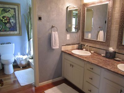 Hot Springs condo rental - Master bath with double vanity.Shower and whirlpool to the left. Large closet.