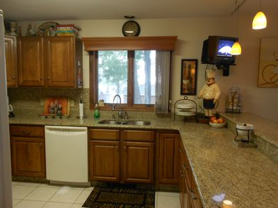 Laconia condo rental - Beautiful granite countertops and laundry room in half bath on main level.....