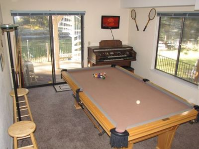 Regulation-size Olhausen pool table for the aficionado, Thomas organ, HDTV.
