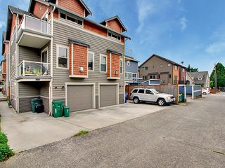 Seattle townhome photo - This is a view of the back alley of the building and 1 uncovered parking space.