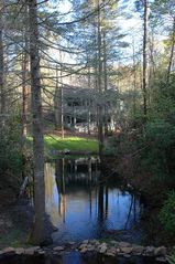Cashiers estate photo - Long View of Home with Trout Pond