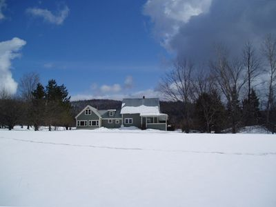 A back view of the farmhouse in the winter