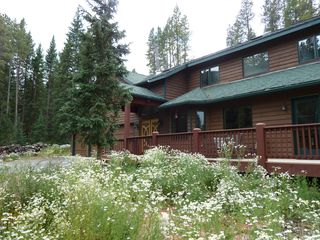 Blue River house photo - Wildflowers surround the house during summer