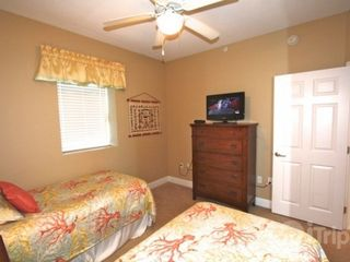 "Gulf Shores condo photo - 25"" TV/DVD in guest bedroom"