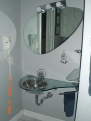 Key West house photo - Master bath sink and mirror