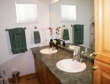 1 of two bathrooms, this one with tub & 2 sinks