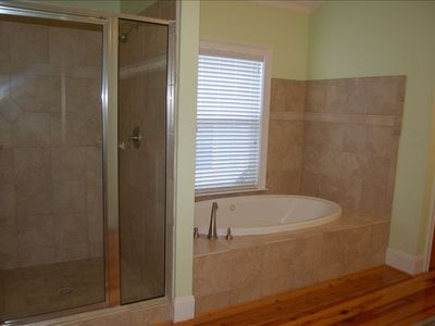 Jacuzzi tub , European walk-in shower, his/hers sink.  Coffee maker, fridge.