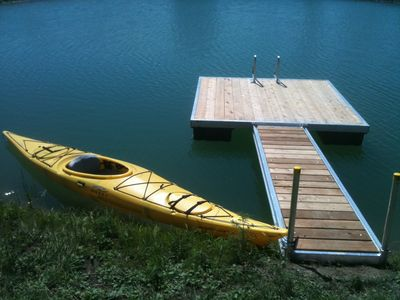 3/4-acre pond with docked kayak