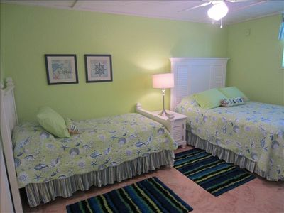 Queen Bed + twin bed with a trundle under!