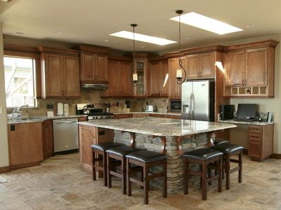 Fully Equipped Gourmet Kitchen with a Large Granite Island Bar and Ocean Views