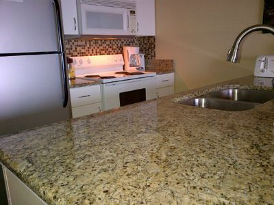 New Granite Countertops/Backsplash in the Kitchen along with a new Delta Faucet.